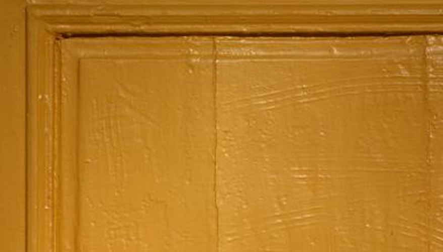 Consider sanding and painting your kitchen cabinets on your own.