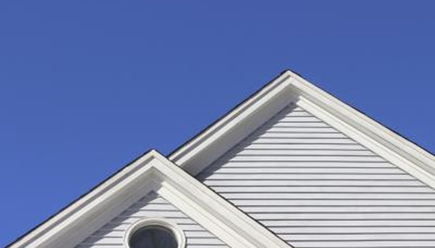 Image of the top of a home with a clapboard exterior.