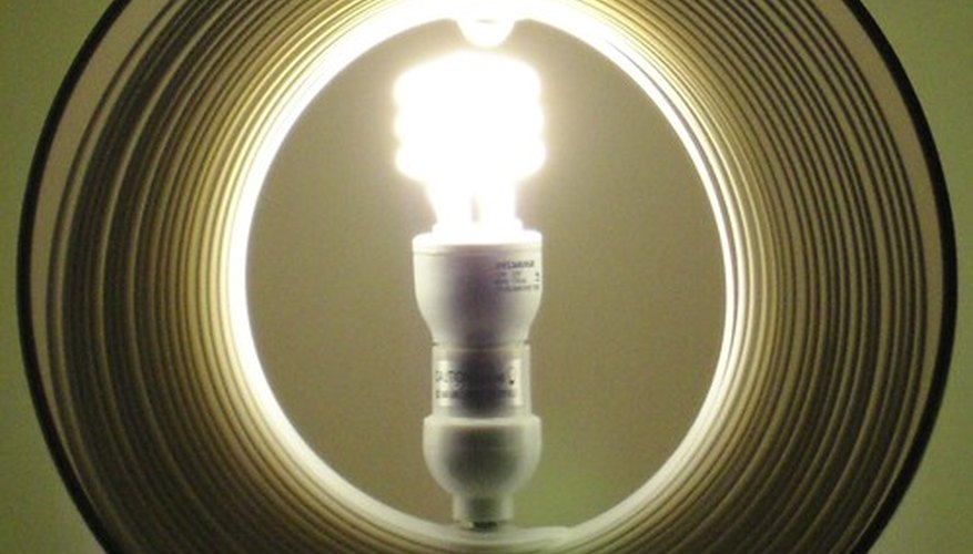 Lumens measure the light radiated by the bulb. Foot-candles measure the illuminance of the ring around the bulb.
