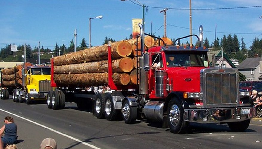 Peterbilt perfected the design and implemenation of the modern logging tractor-trailer rig.