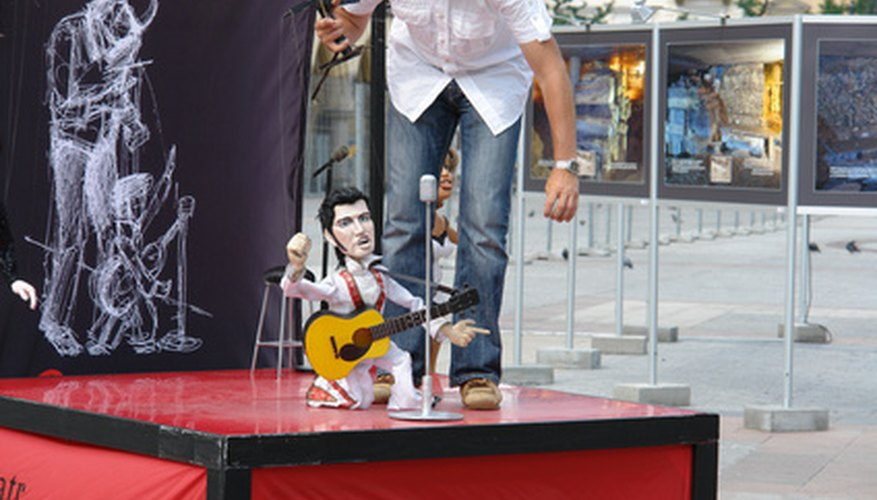 Elvis Presley has been represented in all kinds of souvenirs, such as puppets (as here) and stamps.