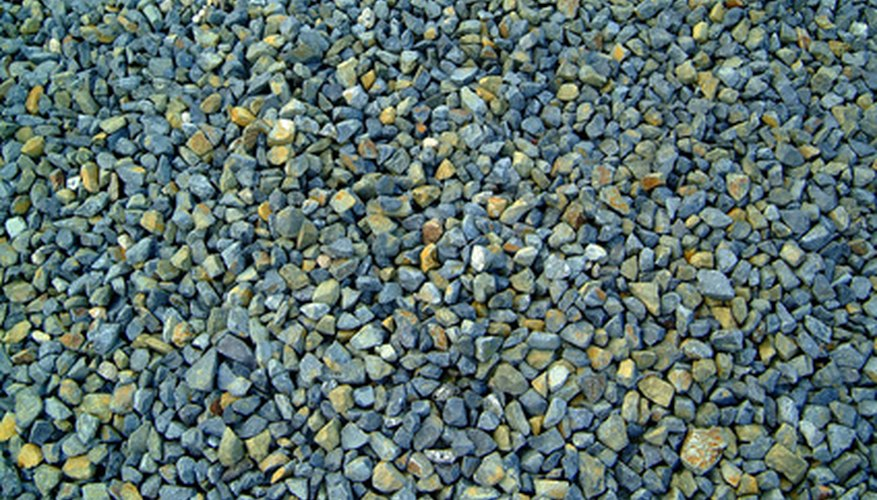Colored gravel adds texture and accent to a flower bed.