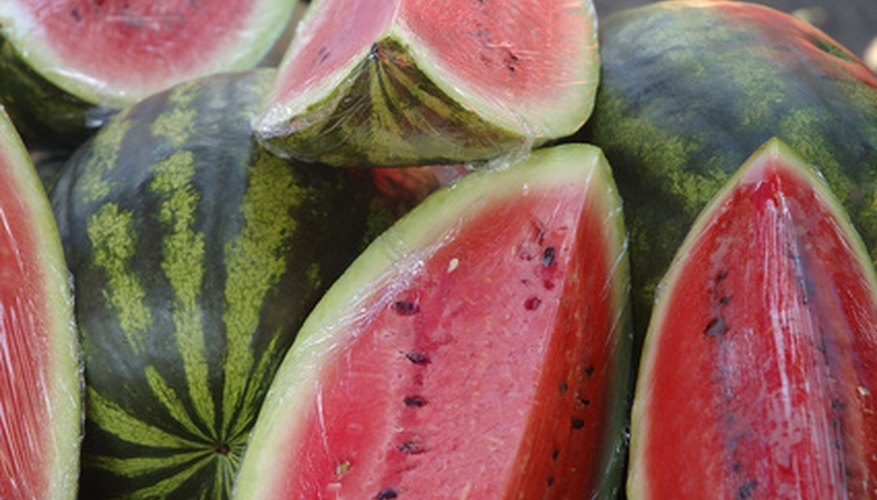 Watermelon plants produce few fruits per vine.