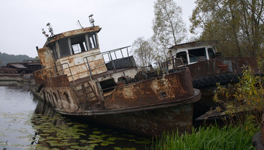 blasted rusty boat in the river near of Chernobyl