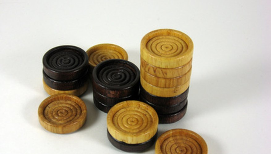 While the iconic, plastic checkers are often red and black, wooden pieces are usually found in dark and light brown.