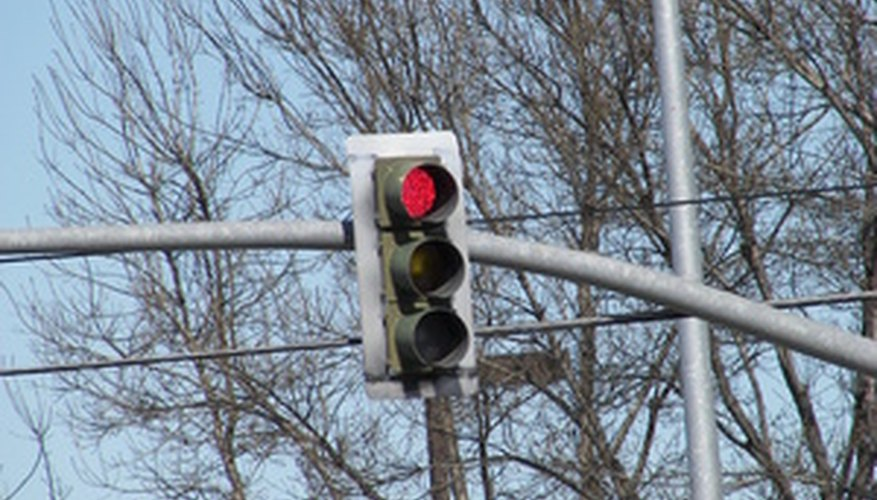 Running a red light is one traffic violation that can increase premiums.