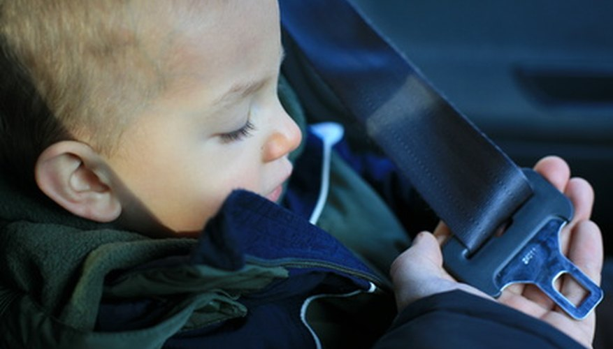 Pull the shoulder strap around child and secure the buckle.