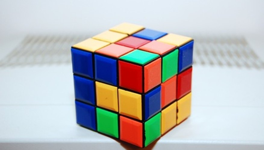 Use algorithms to solve a Rubik's cube.