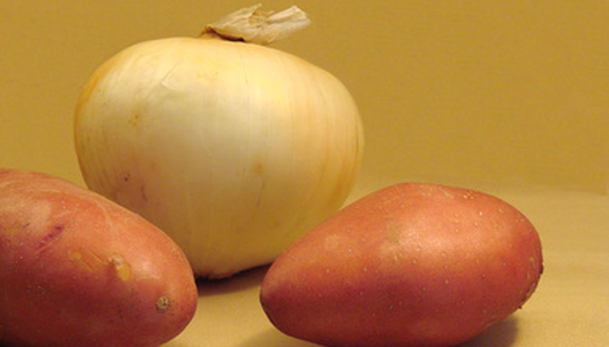 Potatoes and onions typically are not grown from seed like most vegetables.