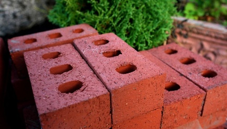 Landscaping blocks make a sturdy and often inexpensive material to edge garden beds with and can be adapted to any shape you want.