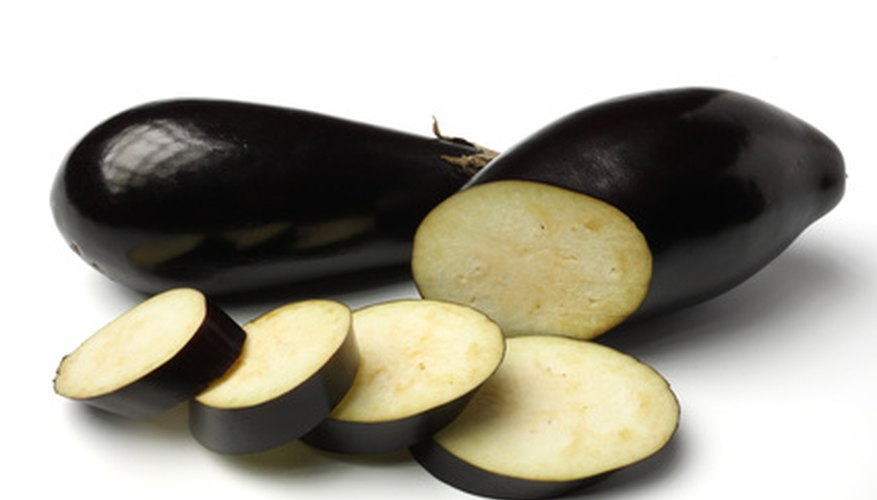 Pick eggplants from the garden when they mature.