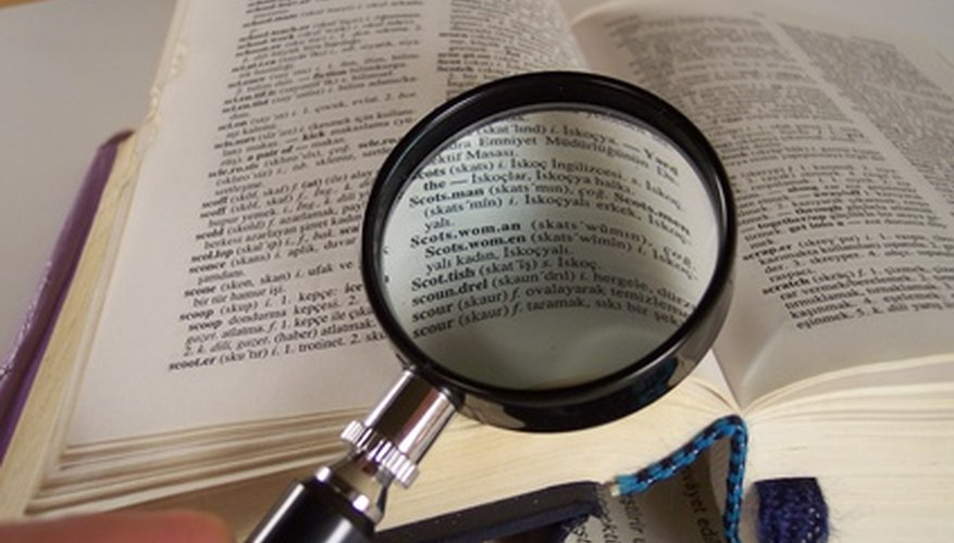 The elderly commonly use magnifying glasses to read small print.