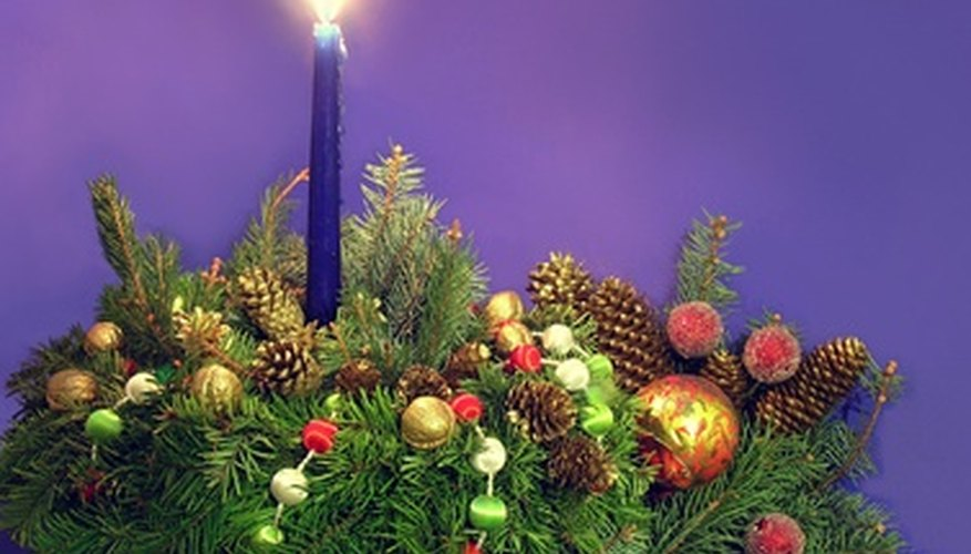 A fragrant evergreen centerpiece is glowing with candle light.