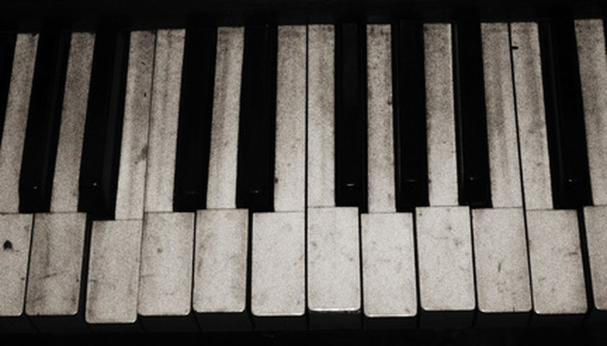 Ivory keys may indicate an antique reed organ.