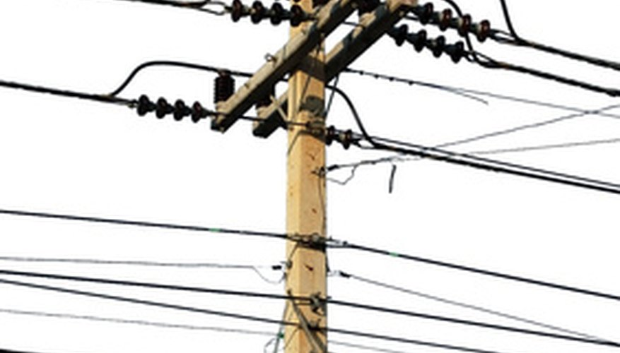 Each of the lines on utility poles serve a specific function.