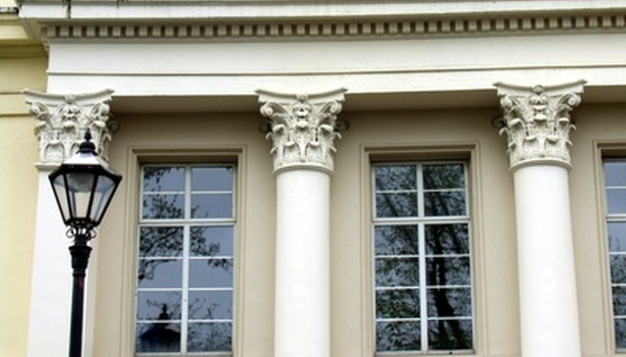 The tops of Corinthian columns are intricate and detailed.