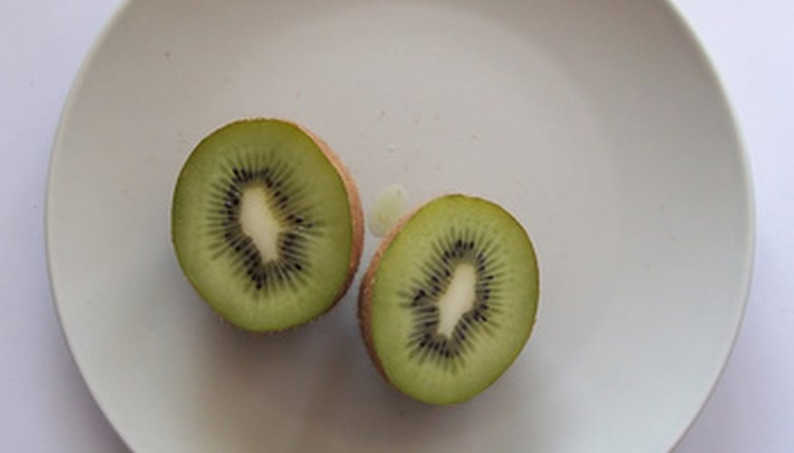 Kiwifruit are grown on an arbor or trellis.