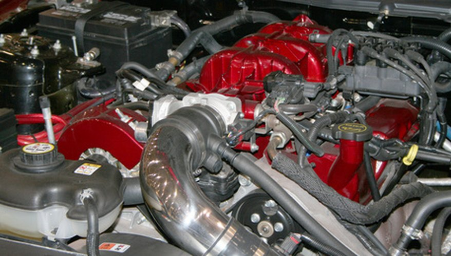new car engine with red trim