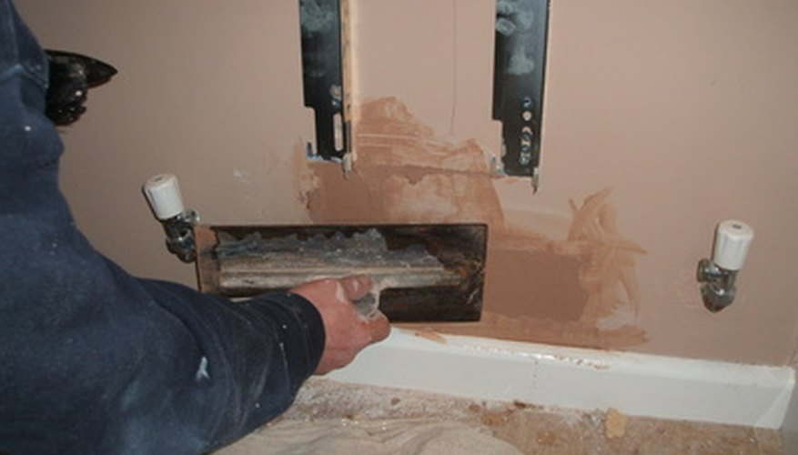 A thin coat of patch plaster should take care of any damage to the wall.