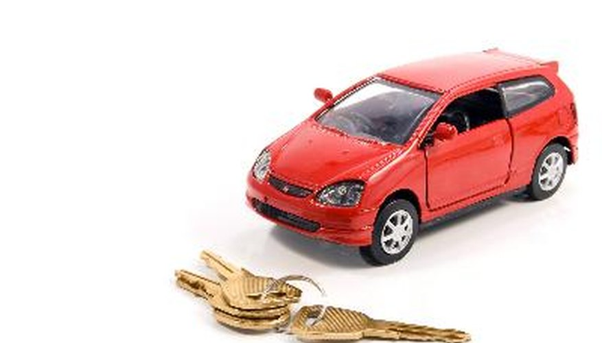 Toy car and keys over white. Rent or buy car concept