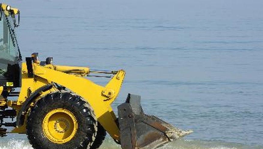 bulldozer on a beach on background of sea