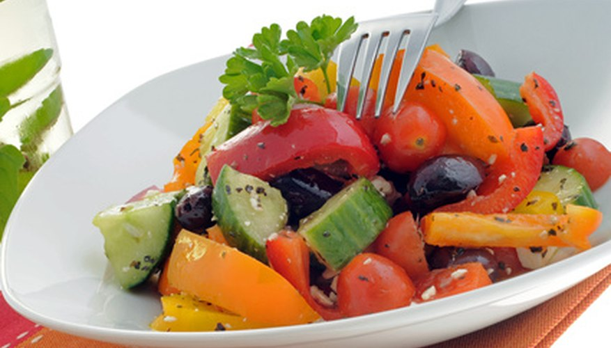 Fresh strawberries and tomatoes make a nice addition to summer salads.