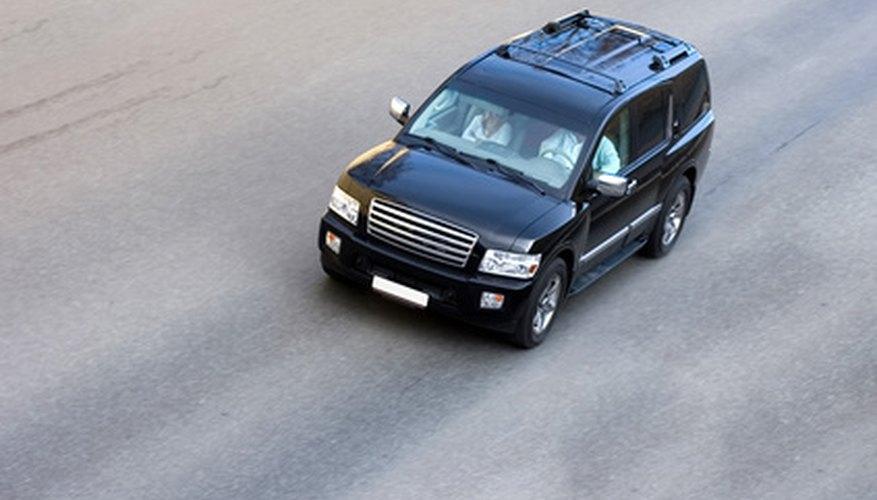 luxury big heavy suv car speed isolated on road