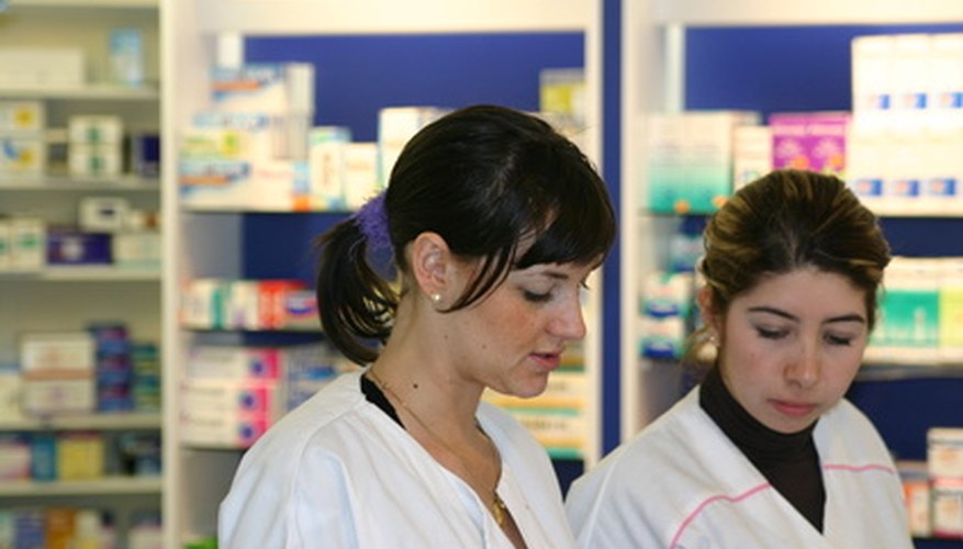 Pharmacy techs help customers with prescriptions.