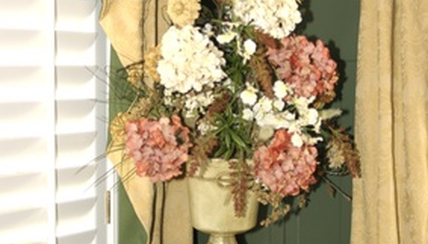 A flower arrangement on a pedestal must be perfectly balanced.