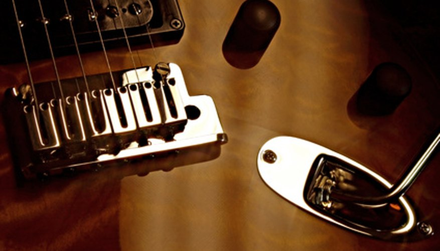 Exposed humbucker pickups without metal covers are common.