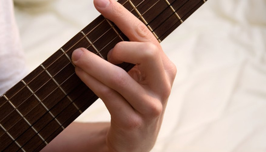 Nylon strings make it easier to finger chords.