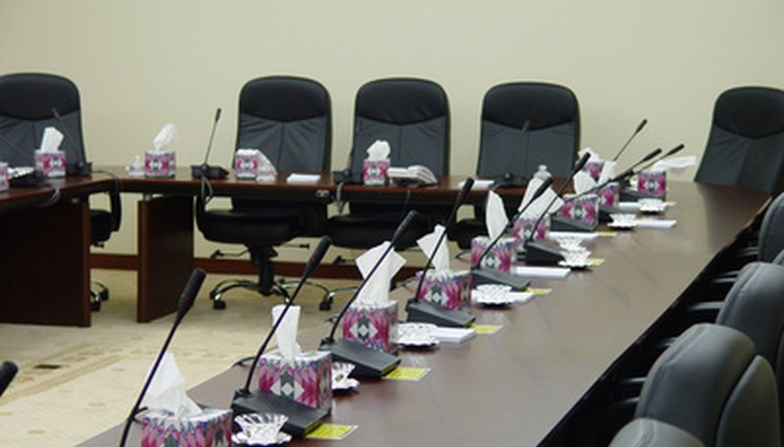 Social Security hearings take place in a conference room or meeting hall.