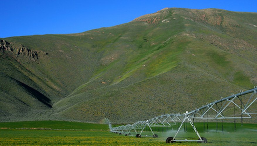 Center pivot systems are used to irrigate flat terrain.
