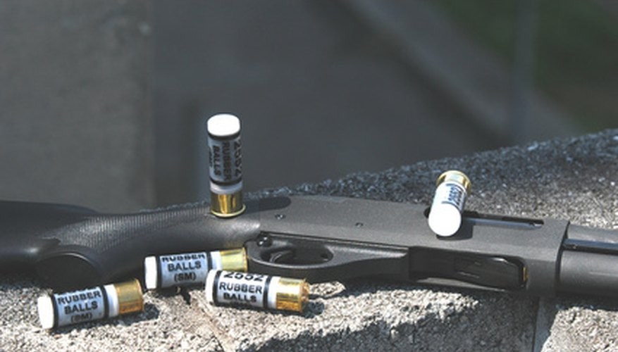 The stock of a shotgun is attached with a butt-stock screw.