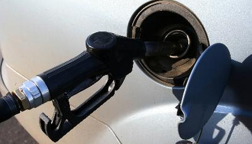 filling up auto tank at gas station