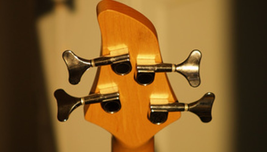 A four string bass guitar's tuning pegs