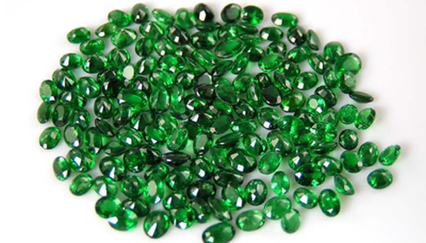 An untrained eye might associate green gemstones with emeralds without realizing that other gems such as this garnet can also appear green.