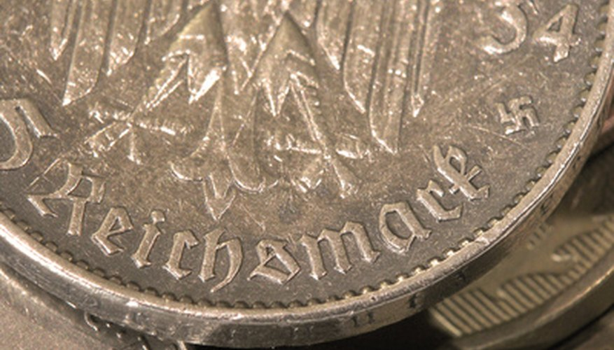 Old coins will have age and grit within their grooves; it's a mistake to clean them with home cleaning products.