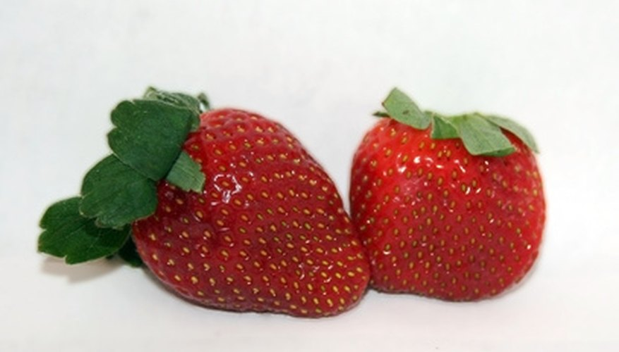 Strawberries grow well in half barrels.