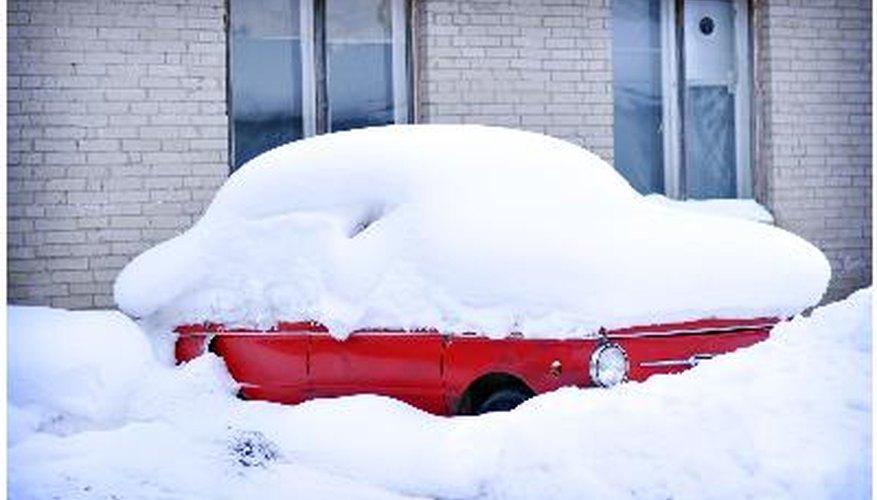 Car sleeping under the snow coat