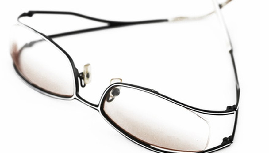 Optometrists prescribe corrective lenses to patients.