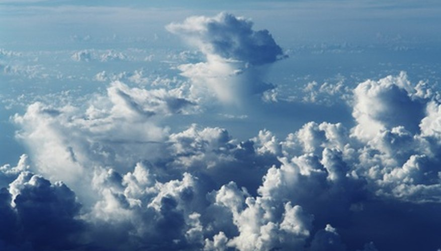 Cumulus clouds span from low to high altitude.
