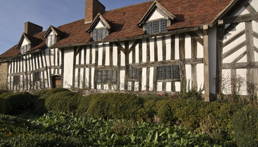 Make a simple model of a Tudor house from cardboard shoeboxes.
