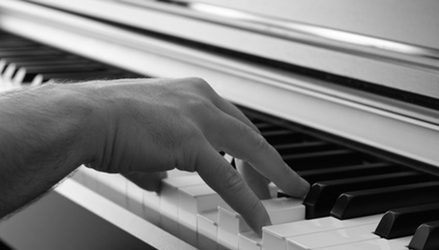 A hand in piano playing position.