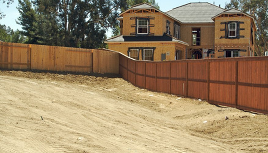 You can find the owner of an empty lot in county or city property records.