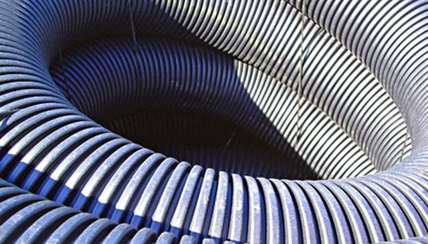 Corrugated drain pipe is used in a French drain.