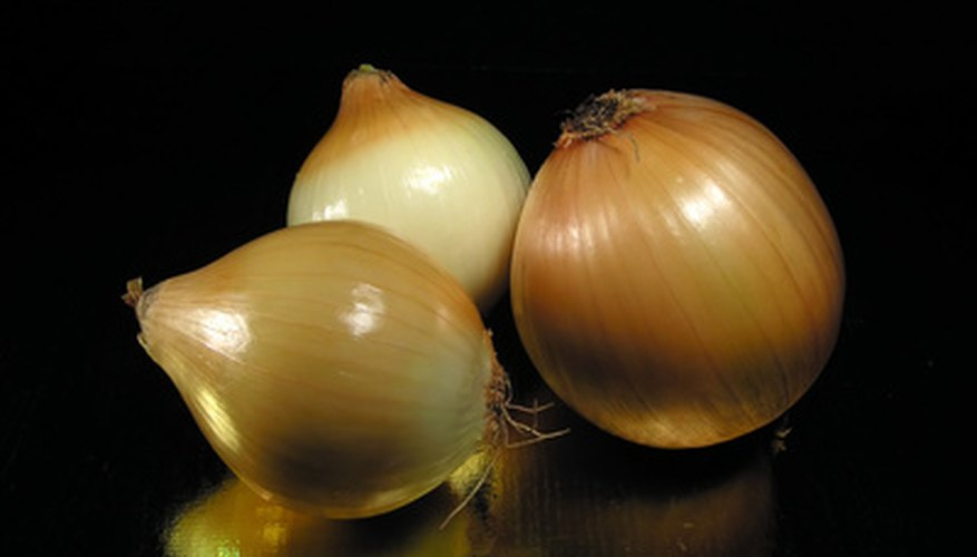 Onions are generally considered beneficial in the garden, but can have a negative impact on some plants.