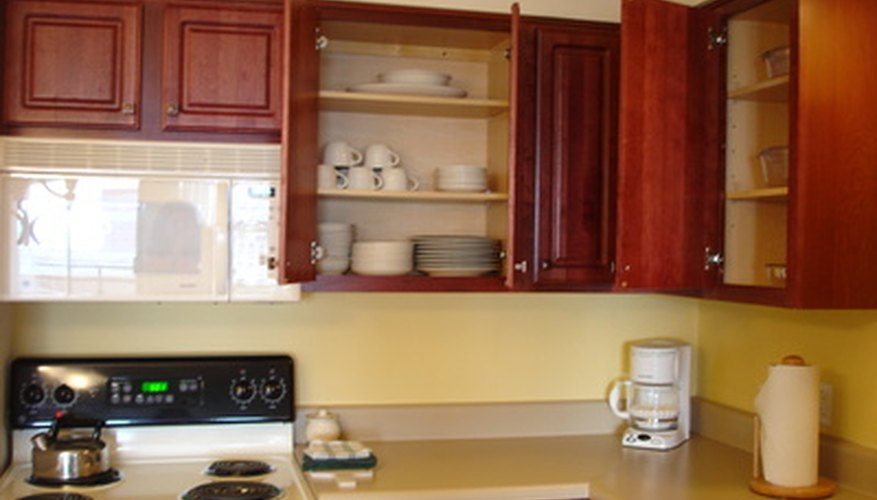 Wooden cabinets can support plate racks.