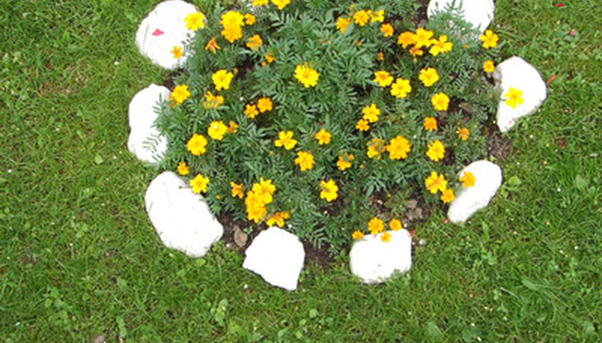Simple stone edgings protect flower beds from mowers and trimmers.