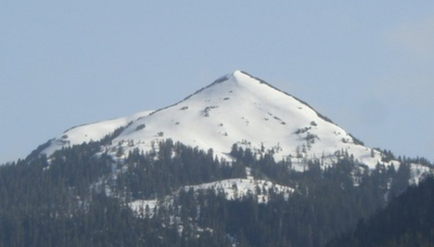Mountains that rise to great heights are often snow covered, reflecting the effects of vertical climate on the higher elevations.